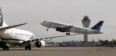 Jet departed Seattle-Tacoma International Airport Tuesday. Slightly more than half of Tuesday's 2,000 delays were because of controller furloughs.